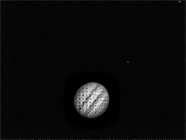 Jupiter: Dark spot is shadow of Io.  Ganymede is to the upper right.