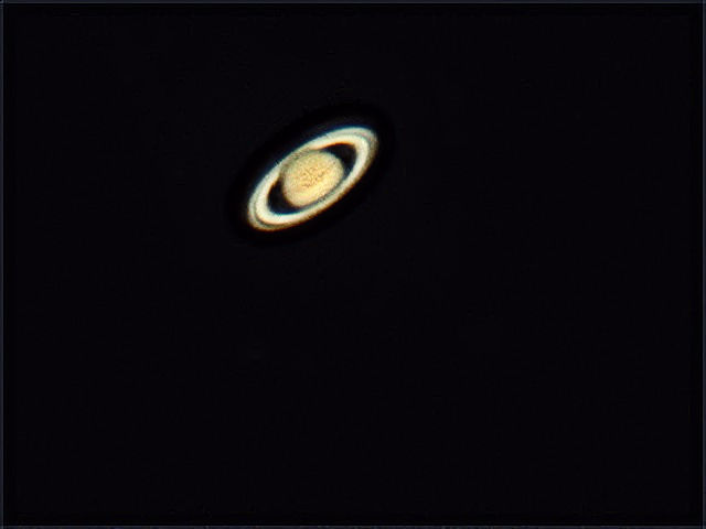 Saturn: Note Cassini division visible in ring plane.